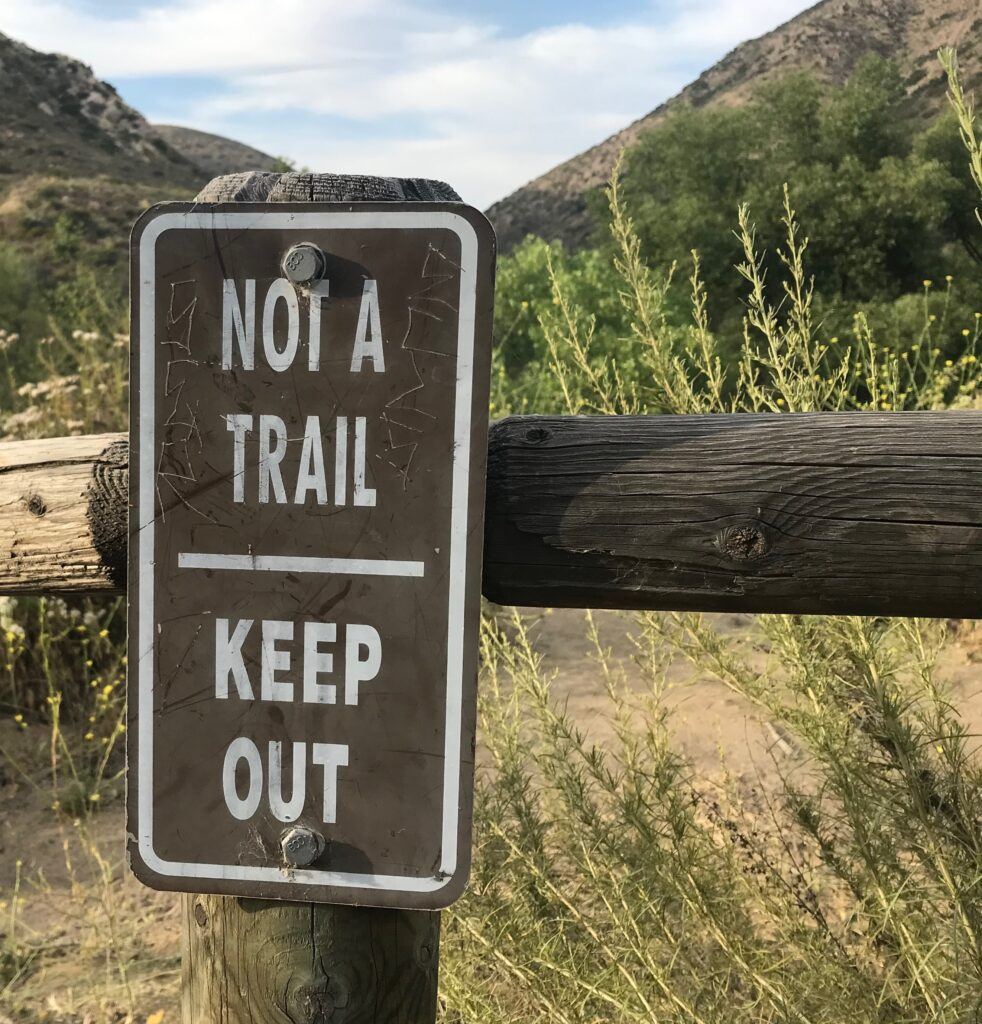 Keep out trail sign